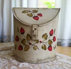 Vintage tin canister with hand painted strawberry spray