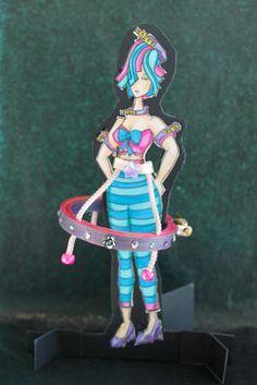 "Hoop-La Girl by Patricia Chamberlain.  3"" wooden hoop, paper, cardboard, ribbon, crystals, beads, art markers."