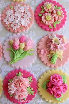 cupcakes with AMAZINGLY intricate fondant flowers...tulips, roses...just beautiful!!!!