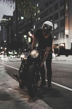 // There's something about a man on a bike wearing a helmet. Who lies beneath?