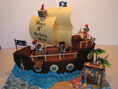 Made this for my sons 6th Birthday. Inspired by many here on CC. Caramel cake (Thx to MacsMom!) filled with Milky Way filling. Iced in Chocolate Whipped Cream. Treasure chest is 100% edible! (chocolate, fondant, marshmallows) Added his Playmobile Pirate toys, paper sails on dowel masts, toothpicks  skewer rails. Crows Nest is ice cream cone covered in chocolate. This cake was SOOOOOO much fun to make!