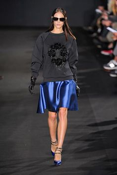 Prabal Gurung Fall 2012  This was a luxe effort with tons of satin and embellishments. Even a black sweatshirt looked ultra posh with a sequined version of an animal skull motif and worn with a shiny blue skirt. It's just this kind of effortless mix of high end and laid back that has made Gurung such a hit among the young, pretty and well-heeled.