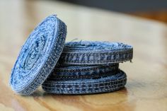 These cool looking coasters made from old denim will protect your tabletops –– 18 Ideas For Upcycling Denim