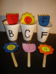 Flowerpot Alphabet Match-Match lowercase letter flower popsicle sticks to uppercase letter flowerpots (styrofoam cups).