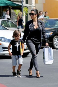 Kim Kardashian takes her nephew Mason to the movies and then shopping at Barnes and Noble on August 19, 2014