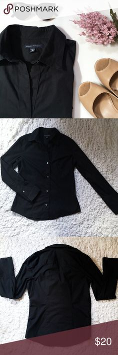 Classic Black Button-Down Shirt Classic stretch button down shirt. Measures 20 inches across (armpit to armpit) and 24 inches long. 96% Cotton, 4% Lycra/Spandex. Excellent condition. Banana Republic Tops Button Down Shirts