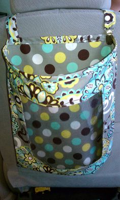 We must make this!!! Car storage bag. Kids can see everything inside, but all toys and goodies are off the floor. A must make for the car! --- Funny how in the pic there is a toy still on the floor, but cute idea anyway :)
