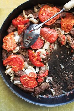 From SAVEUR Issue #168 Lebanese seven-spice powder—a mix of allspice, black pepper, cinnamon, cloves, fenugreek, ginger, and nutmeg known as baharat—flavors the lamb patties as well as the tomatoes in this richly spiced dish from Lebanese chef Fouad Kassab's mother, Isabelle.