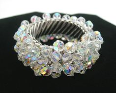 Fun, sparkling AB crystal beads shake and move on this beautiful vintage 1960s expansion bracelet!  The faceted crystal beads are aurora borealis coated giving them even more flash and color on movement.  Fun cha-cha bracelet; marked Japan.  Measures 1-1/4 wide and will fit almost any wrist as it expands and stretches.  This is in MINTY condition and very clean.  Gift for her, Valentine gift, Christmas gift, Mothers Day gift, birthday gift, etc.  Ships first class, 5-7 days delivery time...