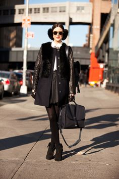 Take notes: pleated skirt plus edgy leather plus fun fuzzy earmuffs equals an A+. Photo by Mark Iantosca New York Fashion Week Street Style, Nyfw Street Style, Fashion Week 2015, Street Style Looks, 2015 Trends, Winter Accessories, Look Chic, Fashion Pictures, Plus Size Fashion