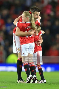Michael Carrick of Manchester United embraces his children Louise and Jacey at the end of the Barclays Premier League match between Manchester United and AFC Bournemouth at Old Trafford on May 2016 in Manchester, England. Manchester United, Manchester England, Michael Carrick, Boy Girl Names, Afc Bournemouth, Barclay Premier League, Unique Baby Gifts, Premier League Matches, Old Trafford