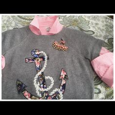 NWOT,JCrew Floral Anchor Sweatshirt Tee NWOT, never worn short sleeved sweatshirt tee! This raglan-sleeve fleece tee combines two of JCrew's favorite things-florals & an anchor motif! The anchor is designed from a woven floral print that is finished with the cutest embroidered rope for a distinctive dash of color & texture!  Such a perfect top on its own, or slip a cute patterned or striped button down underneath until springs arrival! A blogger favorite!  J. Crew Tops Sweatshirts & Hoodies