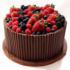 Chocolate cigarillo cake with fresh fruit....beautiful presentation