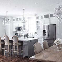 I like the grey island in this one contrasting with the white kitchen