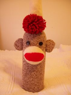 This cute little wine bottle cover is made from a genuine red heel sock. For those who like sock monkeys, what better way to present a gift bottle of wine. The red pompom ties in the back of the bottle, shown in the last photo. I used buttons for the eyes, so this is not for young children to play with. It is modeled on a 750ml. bottle and it fits perfectly... Thank you for looking! LuvLynda