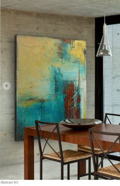 Large scale art, like this painting by Erin Ashley, creates a focal point in the room. | Available greatbigconvas.com