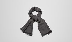 Bottega Veneta -Anthracite Black Cashmere Wool Silk Scarf - Understated elegance and supreme simplicity are the hallmarks of this iconic Bottega Veneta scarf. Flawlessly crafted in a luxurious blend of wool and silk, this timeless, frayed-trim design has been finished with a signature butterfly