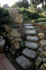concrete bags for steps up a sloping side; keep wet for week, let dry, peel off paper, tint with concrete stain or paint if desired