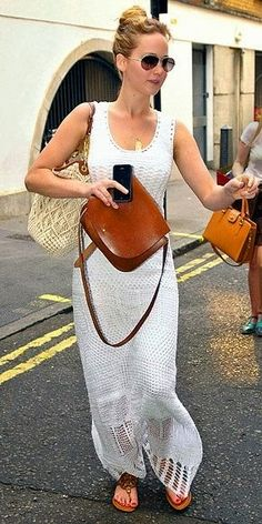 Jennifer Lawrence.. and those sandals look like our biggie black sandal!