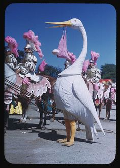 A Ringling Brothers Barnum & Bailey Circus performer inside of a stork costume during a pageant. Chicago, Illinois, 1949.