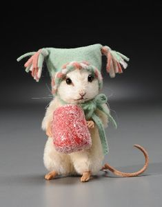 "Meet ""Sugar"" - the R. John Wright 2011 Christmas Mouse. This link will take you to a great doll retailer. Click through to see what else they have!"