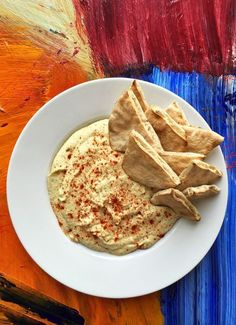 Alton Brown's Hummus Recipe: Not only is it better than store-bought, you can whip this dip up in no time (no need to soak the beans).