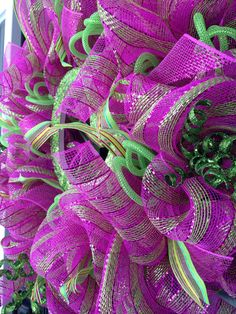 Pink and lime green mesh wreath, with ribbon, green curly sticks, green mesh tubing and sparkly initial!