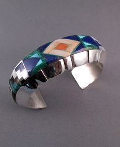 Cuff | Alvin Yellowhorse (Navajo). Sterling silver inlaid with turquoise, lapis, malachite, mother of pearl, spiny oyster shell and onyx.