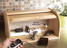 Charger Hideaway: use a breadbox to store and hide charger cords! Click to see more #clutter busing #DIY ideas