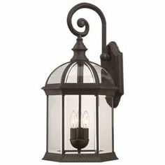 """3-light outdoor wall lantern.    Product: Outdoor wall lanternConstruction Material: Glass and metalColor: Black and clearFeatures: Suitable for outdoor useAccommodates: (3) 60 Watt type B incandescent bulbs - not includedDimensions: 26.25"""" H x 13"""" W x 12.5"""" D"""