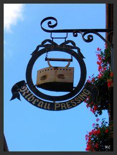 Modern' Pressing sign