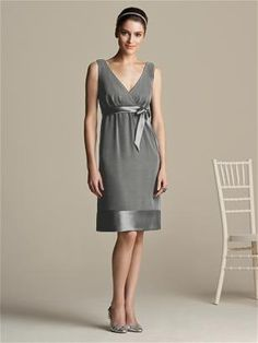 Cocktail length nu-georgette v-neck dress with matching matte satin trim at empire waist and hem