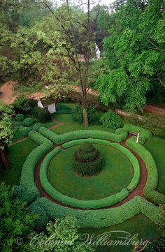 Boxwood hedges and topiaries in the Greenhow Tenement garden. 18th Century scene at historic Colonial Williamsburg, Williamsburg, Virginia. Photo by David M. Doody.