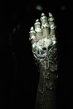 'Contra Mundum', a diamond, white gold, and platinum chainmaille gauntlet designed by Daphne Guinness in collaboration with jeweler Shaun Leane. The name of the piece means 'Against the world', and it was conceived by Daphne as armor.