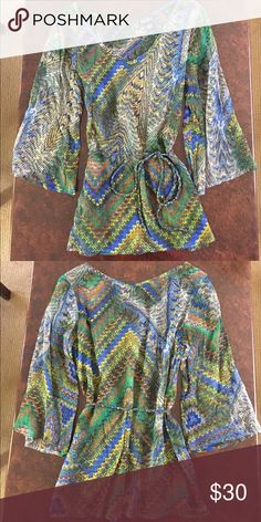 LUCKY tunic top size small LUCKY tunic top - ties at waist with removable tie - is somewhat sheer so you might want to wear a camisole or tank under it - excellent used condition Lucky Brand Tops Tunics