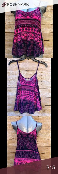 Woman's elephant spaghetti strap tank top D3 Woman's elephant print spaghetti tank top  Size medium  Flowy fit stretchy slinky fit   Gently Preowned: only worn and washed a few times. No rips holes tears or stains. Pictures are of the actual item you will be receiving. No surprises.   Clean smoke free home free kisses Tops Tank Tops