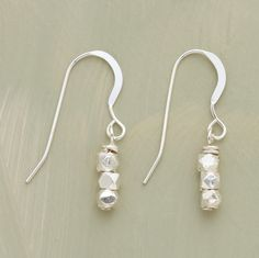 "STACKS OF STERLING EARRINGS -- Three faceted sterling silver nuggets are stacked and suspended from silver French wires. Handmade. Exclusive. Approx. 1""L."