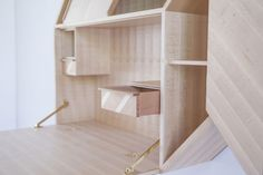 Facet by Kunsik, a wall mounted cabinet which can be used both as a storage and a writing desk.