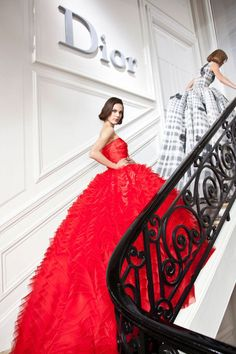 Inspiration?  Yes---creativity.  Stunning Red Dior Gown Love how the gown flows down the staircase...very chic.