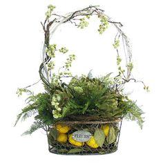 Silk fern, artichoke, and lemon arrangement in a wire basket.  Product: Faux floral arrangementConstruction Material: