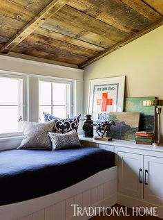 A built-in daybed perfect for curling up with a good book finds a home amongst the many nooks and crannies this farmhouse offers. Cozy Cabin, Cozy Cottage, Cottage Style, Style At Home, Built In Daybed, Bunk Rooms, Interior Design, Coastal Interior, Interior Ideas