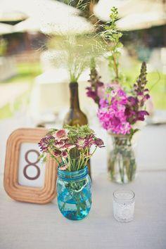 sweet centerpieces // photo by Amelia Lyon // http://ruffledblog.com/elegant-rustic-malibu-wedding