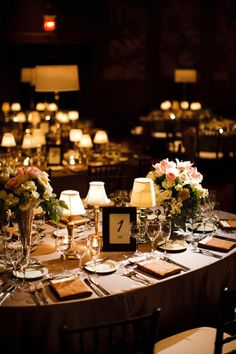 Love the use of lamp lighting on these elegant tables
