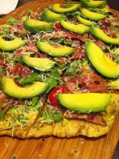 Grilled Prosciutto Pizza: Homemade pesto sauce, prosciutto, sliced avocado, garden tomatoes, arugala garden mix, and caramelized red onions