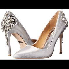 HP 4/6Badgley Mischka pumps These are absolutely stunning! Like seriously gorgeous. Worn once just to try on. Comes with box *I used stock pictures because I don't want to take the wrapping off the jewels. Work Week Chic Hist Pick!!! Badgley Mischka Shoes Heels