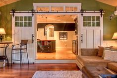 Sliding barn doors between kitchen and family room. We've had a few requests for sliding barn doors in the last couple months! What a great way to decorate a home and have to option to put a sound barrier between living room and kitchen! Home Staging, The Doors, Sliding Doors, Entry Doors, Patio Doors, Sliding Wall, Design Apartment, Garage Apartment Interior, Barn Apartment