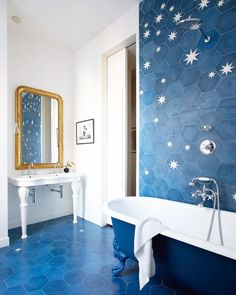 Popham Design star tiles in a blue and white bathroom via Although the blue and white room is a staple in coastal summer design, I find the same Nantucket stripes and ginger jars are over-used this season. Bad Inspiration, Bathroom Inspiration, Bathroom Renos, Bathroom Interior, Bathroom Faucets, Bathroom Ideas, Paris Bathroom, Industrial Bathroom, Bathroom Cabinets