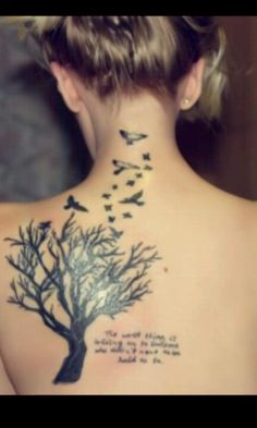 """Tree, birds and quote tattoo - with the quote """"To our children we give two things, one is roots, the other is wings"""""""