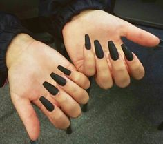 Long, coffin-shaped, matte-black nails
