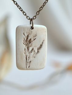 - a sweet porcelain pendant with impression of tiny grass plumes. Pride - a sweet porcelain pendant with impression of tiny grass plumes.Pride - a sweet porcelain pendant with impression of tiny grass plumes. Porcelain Jewelry, Ceramic Jewelry, Ceramic Beads, Ceramic Clay, Clay Beads, Polymer Clay Jewelry, Concrete Jewelry, Ceramic Necklace, Polymer Clay Kunst